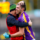 County joy: Ryan Jones celebrates with Derrygonnelly boss Brendan Rasdale after Fermanagh title success