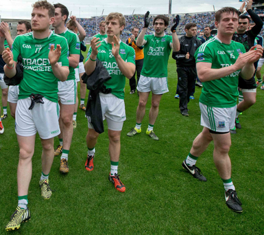 Brave effort: Fermanagh players salute their supporters after the defeat to Dublin