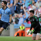 Up and down: Fermanagh keeper Thomas Treacy can only look on as Dublin's Bernard Brogan celebrates his goal