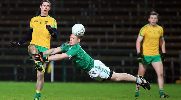 Attack minded: Fermanagh's Tomas Corrigan closes in on Donegal's Caolan Ward