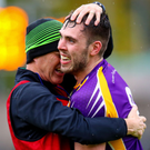 Lead role: Ryan Jones, hugging Brendan Rasdale in celebration, can prove a driving force for Derrygonnelly Harps