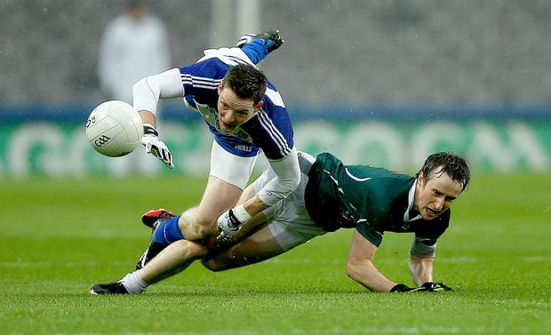 Conor McManus of Monaghan wrestles with Ollie Lyons of Kildare