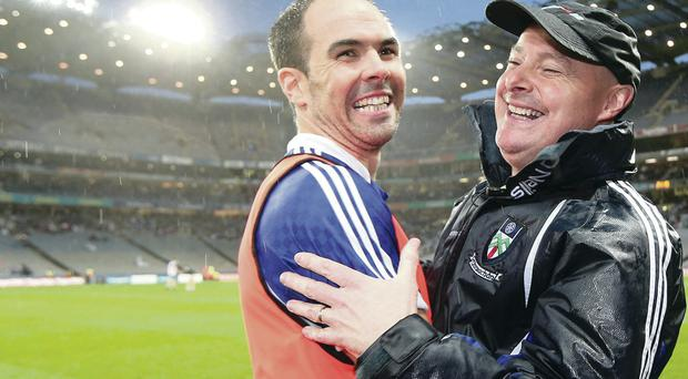 Happy men: Monaghan manager Malachy O'Rourke celebrates with Paul Finlay