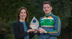 Top man: Conor McManus receives his International Rules award from Valerie Hedin, External Communications Manager at EirGrid