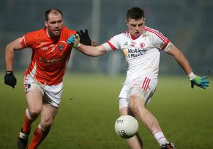 Tyrone's Connor McAliskey under pressure from Armagh's Ciaran McKeever at the Athletic Grounds