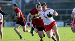 On song: Ronan O'Neill of Tyrone, back after a year out of the side, with Down's Gerard Collins