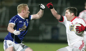 Tough battle: Tyrone's Dermot Carlin clashes with Cavan's Cian Mackey last night