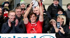 Silver lining: Kieran McGeary lifts the Dr McKenna Cup after Tyrone captured the prize for the 12th time under manager Mickey Harte's command