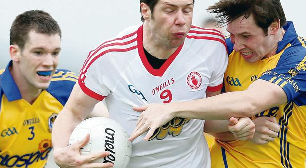 Roscommon's Niall Carty and David Keenan with Sean Cavanagh of Tyrone