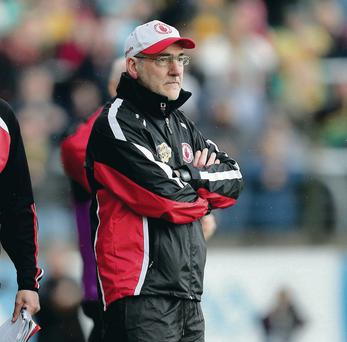 Tyrone's manager manager Mickey Harte look on dejected