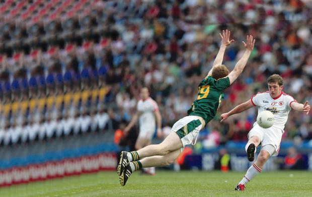 Challenged: Tyrone's Dermot Carlin is confronted by Ciaran Lenihan