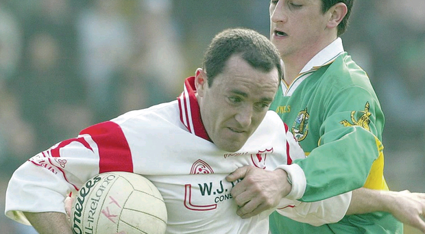 Paul Galvin of Kerry gets to grips with Tyrone's Brian Dooher back in 2003, the last time the Red Hands tasted victory in the Kingdom
