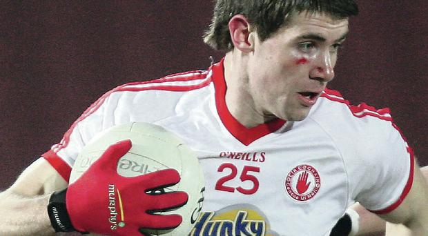Seize the day: Conan Grugan has had to be patient but finally gets his big opportunity with Tyrone