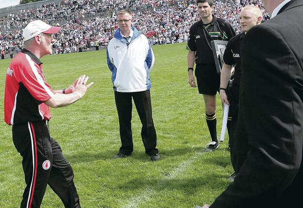 Not happy: Tyrone manager Mickey Harte confronts referee Eddie Kinsella at the end of the game
