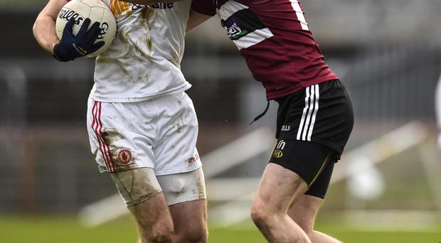 Up close: Tyrone's Ronan McNamee holds off Barry O'Hagan of St Mary's