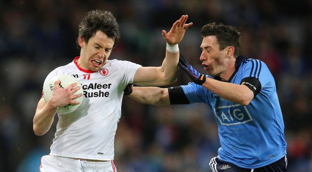 Up close: Tyrone's Mattie Donnelly takes on Dublin's Nicky Devereux at Croke Park