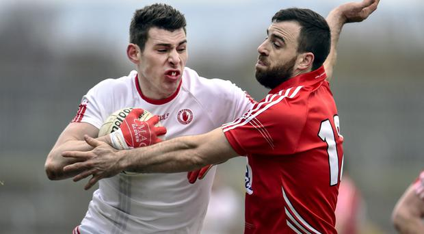 Hold on: Cork's Colm O'Driscoll challenges Padraig McNulty
