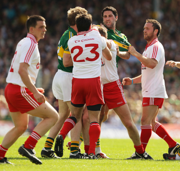 Showdown: Tyrone's clashes with Kerry are renowned for their edge, like this match in 2012 when Ryan McMenamin got to grips with the Kingdom's Bryan Sheehan