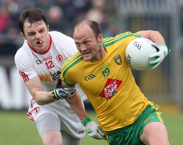 Close up: Donegal's Colm McFadden is held back by Tyrone's Barry Tierney in their Ulster SFC preliminary round tussle