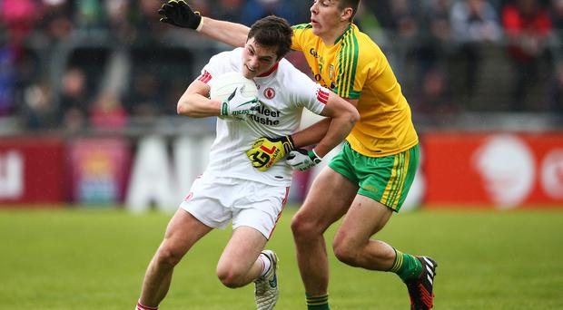 Gripping affair: Donegal's Michael Carroll tackles David Mulgrew of Tyrone