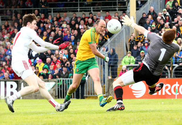 Taking aim: Donegal's Colm McFadden has his shot saved by Tyrone goalkeeper Michael O'Neill
