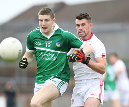 Chasing the prize: Brian Fanning of Limerick is pursued by Darren McCurry