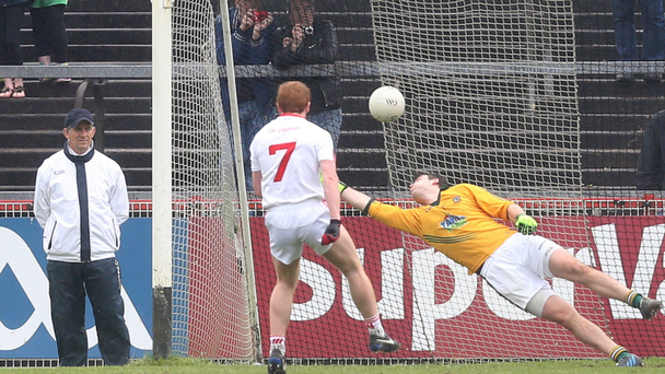 Pick it out: Tyrone's Peter Harte scores a goal from the penalty spot past Meath's Conor McHugh ANDREW PATON/PRESSEYE
