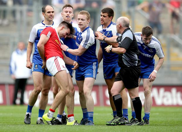 Cornered at Croke: Tyrone's Tiernan McCann is surrounded by Monaghan players