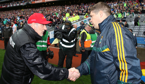 Well done: Mickey Harte shakes hands with opposite number Eamonn Fitzmaurice