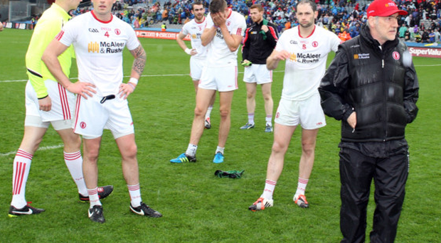 Joy and woe: Tyrone players, and boss Mickey Harte, devastated at the end
