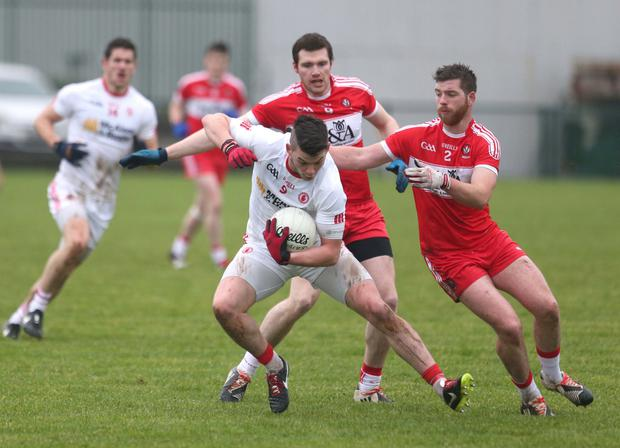 Rich pickings: Tyrone's Richie Donnelly battling with Derry's Brian Og McGilligan yesterday at Oliver Plunkett Park, Crossmaglen