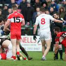 Heat of battle: Tyrone and Derry players scuffle at Owenbeg