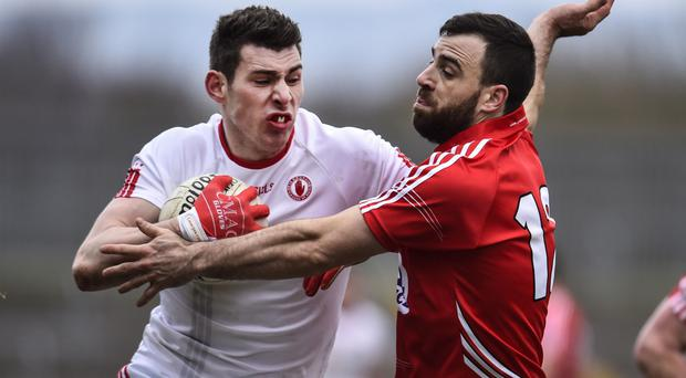 Top marks: Padraig McNulty (left) scored a crucial goal that helped Tyrone to victory over Laois