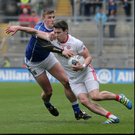 Fired up: Tyrone's Mattie Donnelly takes on Cavan's Liam Buchanan at Croke Park yesterday