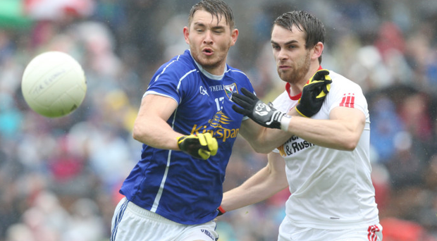 Too close to call: David Givney of Cavan is closed down by Ronan McNamee