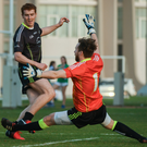 Gulf trip: Tyrone's Peter Harte is blocked by Kerry's Brendan Kealy in the All-Star game in Abu Dhabi yesterday