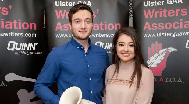Winning ways: Harry Loughran with his GAA Writers' award along with girlfriend Sharon Carberry