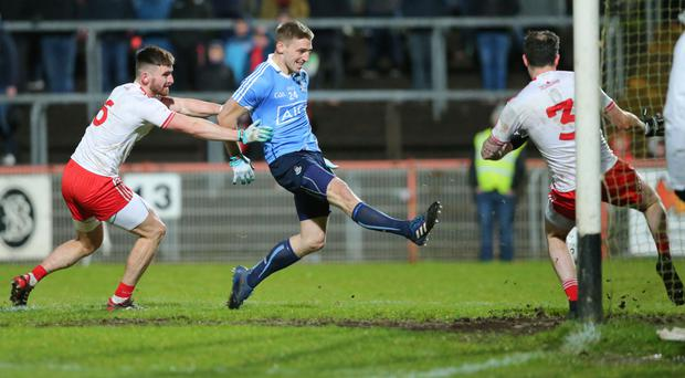 Clinical: Dublin's Eoghan O'Gara punishes a Tyrone mistake with his side's second goal