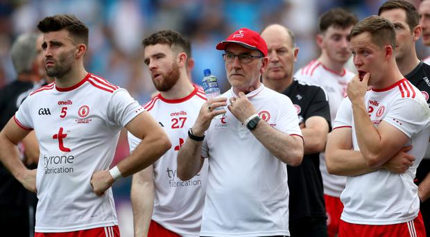 Dejection: Mickey Harte and his players after last month's All-Ireland final loss to Dublin at Croke Park