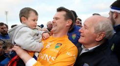 Fitness guru: Coalisland's Peter Donnelly, pictured with son Ollie, who has wielded a big influence within his own county and Cavan