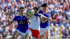 Doubling up: Tyrone's Matthew Donnelly is tackled by Barry Fortune and Dara McVeety of Cavan