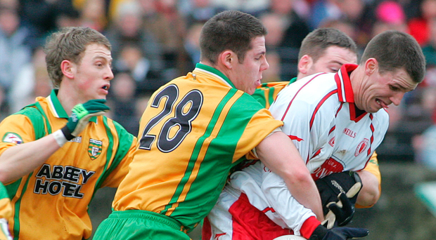 Title target: Minor boss Collie Holmes (right) during his time under the baton of Mickey Harte