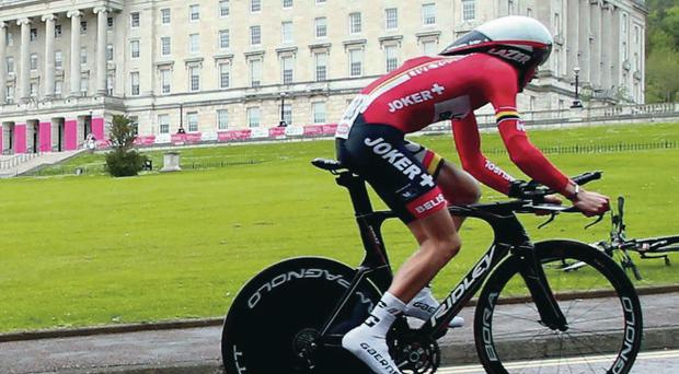 Riding high: a rider from the Lotto-Belisol team cycles up the hill at Stormont during the team time trial