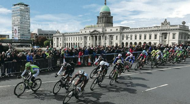 Turning the corner: The Giro d'Italia riders cross Talbot Bridge in Dublin, with Customs House in the background
