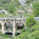 On course: The peloton pedals along a bridge during the fifth stage of the Giro d'Italia