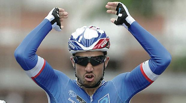 Out of reach: Nacer Bouhanni celebrates as he crosses the finish line to win the seventh stage of the Giro d'Italia