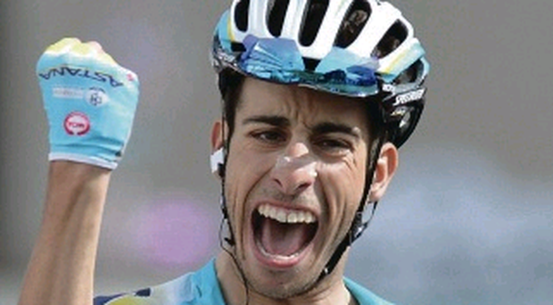 Winner: Italy's Fabio Aru punches the air in delight