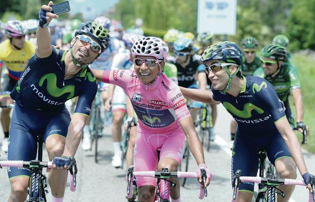 Nairo Quintana poses for a photo after crossing the finish line yesterday