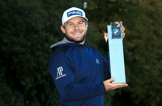 England's Tyrrell Hatton poses with the trophy after winning the 2020 BMW PGA Championship (Adam Davy/PA)