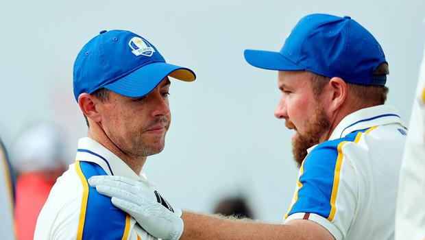 Disappointed Rory McIlroy with his friend Shane Lowry last night on the 16th green at Whistling Straits as the USA blew Europe away to reclaim the Ryder Cup. Credit: Getty Images